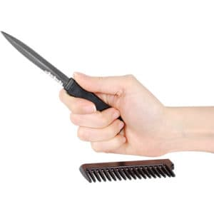 Covert Black Comb Hidden Metal Knife viewed in Hand