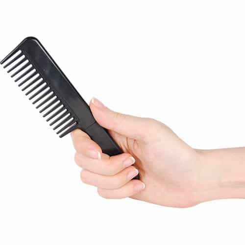 Black Comb with Hidden 3.5 Inch Metal Knife Viewed in Hand Concealed
