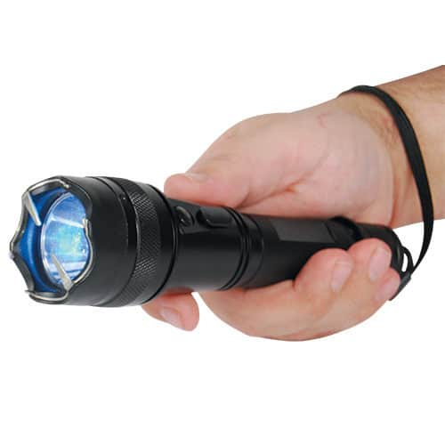 Small Shorty Flashlight 15,000,000 volt Stun Gun Shown in Hand Demonstrating Wrist Strap