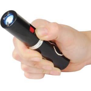 Black Stun Master Lipstick Rechargeable Flashlight Stun Gun Viewed in Hand