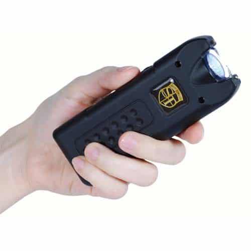 Black MultiGuard Stun Gun Rechargeable with Personal Alarm and LED Flashlight Shown in Hand