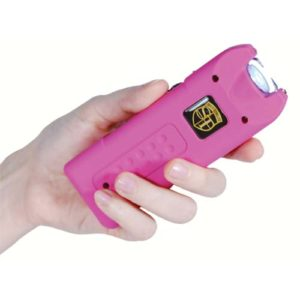 MultiGuard Pink Rechargeable Stun Gun Personal Alarm with LED Flashlight Shown in Woman's Hand