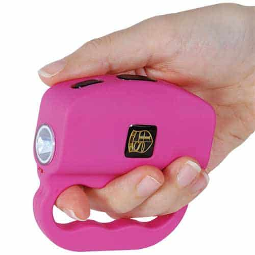 18 Million volt Talon Pink Stun Gun LED Flash Light Displayed Viewed in Hand