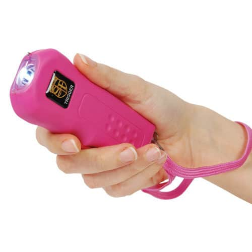 Pink Trigger Rechargeable Stun Gun Flashlight Viewed in Hand with Wrist Strap