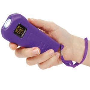 Purple 18,000,000 volt Trigger Rechargeable Stun Guns Viewed in Hand with Wrist Strap