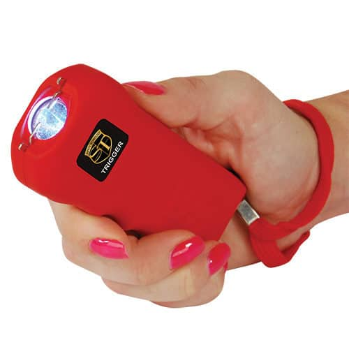 Red Trigger 18,000,000 volt Stun Gun Flashlight Viewed in Hand with Wrist Strap
