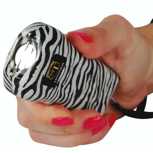 Zebra Trigger Stun Gun Held In Hand View of Flashlight