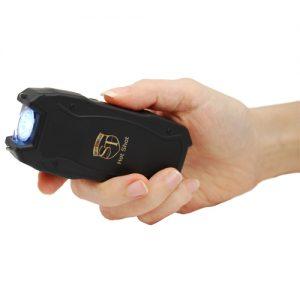 Hot Shot Stun Gun with Flashlight Side View in hand
