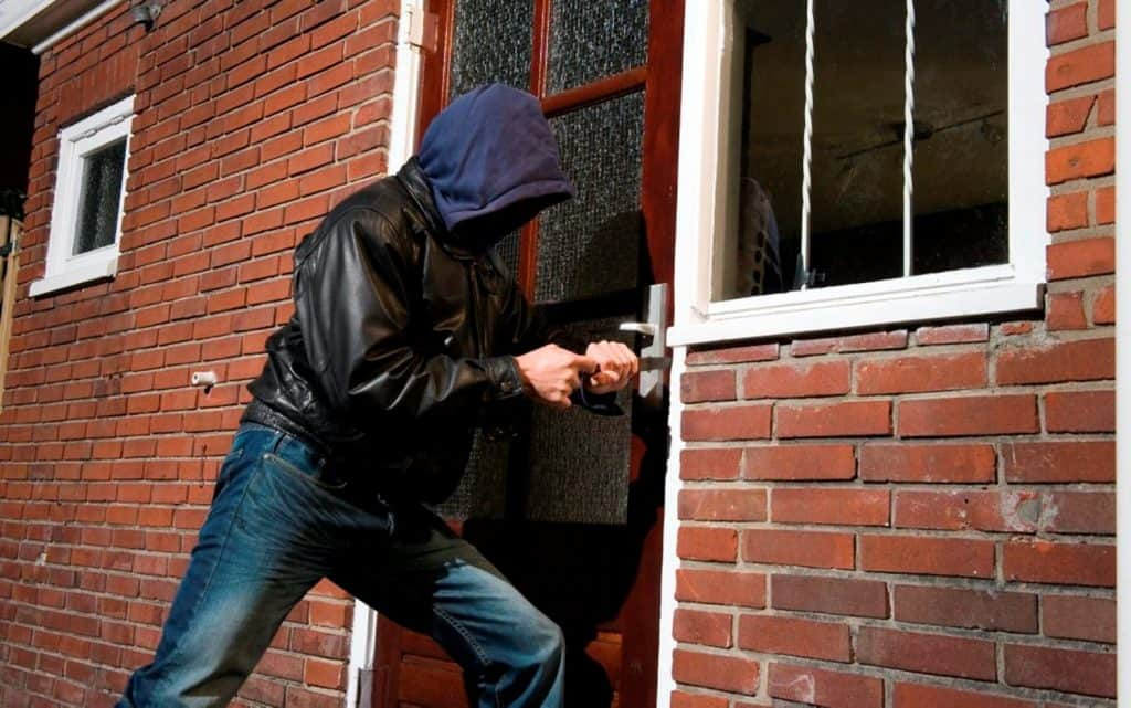 Burglar Breaking into a House - Get a DIY Home Security System